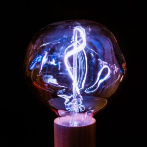 Theory of Change marketing picture of light bulb